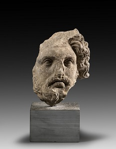 Lot 125: Bearded head. Late Classical / early Hellenistic times, 4th-3rd cent. BC. H. 22 cm. Fragmentary, surface sintered. Ex Dr W.S. Collection, Southern Germany, since the 1970s. Estimate: 2,500,- euros. Hammer price: 42,000,- euros.