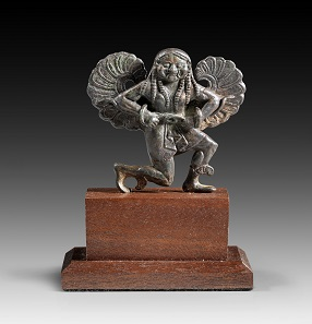 Lot 21a: Gorgo Medusa. Greece, around 500 BC. H 7 cm. Solid bronze cast. From P.M.W. Collection, England. Estimate: 12,000,- euros. Hammer price: 22,000,- euros.