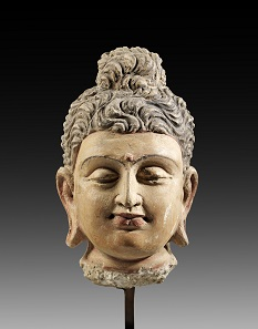 Lot 728: Head of Buddha. Gandhara, 2nd-3rd cent. AD. H 23.5 cm. Terracotta covered with colored plaster. From Kotalla Collection. Estimate: 2,500,- euros. Hammer price: 10,000,- euros.