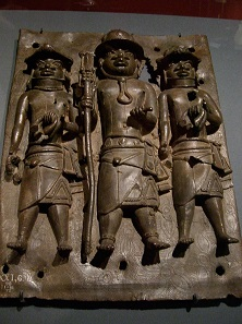 Benin Bronze: the King's local slave agents, holding European manillas in their hands. Photo: UK.