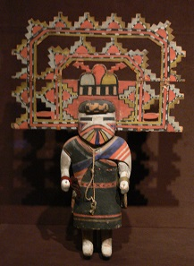 Kachina (tihu) depicting Palhik' Mana (Water Drinking Girl); Hopi people, probably 1920s; 50.8 x 35.9 x 10.2 cm; Wood, paint, and wool yarn; Dallas Museum of Art, Dallas, Texas; given in memory of Congressman James M. Collins by his family; object number 1993.71. Source: Wikimedia Commons.