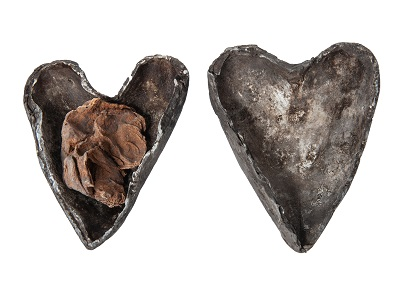 Human heart in heart-shaped lead and silver case. Found concealed in a niche in the pillar in the crypt beneath Christ's Church, Cork, 12th or 13th century. 2.3 x 1.6 cm. © Pitt Rivers Museum, University of Oxford.