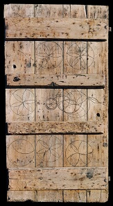 Oak calf-shed door marked with magical symbols to protect livestock. From Laxfield, Suffolk, 19th century. 183 x 94 cm. Private collection.