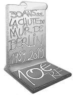 This commemorative coin marking the Fall of the Berlin Wall is struck in a special shape.