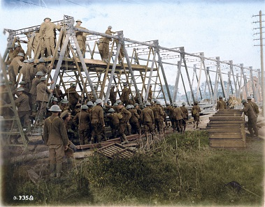By 1918, the Canadian Corps had developed a robust engineering capacity to support the infantry. Twelve engineering battalions built roads and bridges, found water supplies and cleared enemy-laid explosives. The attack at the Canal du Nord could not have succeeded without the bridges that allowed artillery and tanks to cross the divide. Image colourized by Canadian Colour. Photo: George Metcalf Archival Collection, Canadian War Museum.